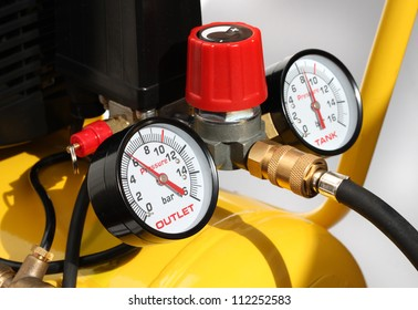 Pressure meters and compressor safety valve closeup