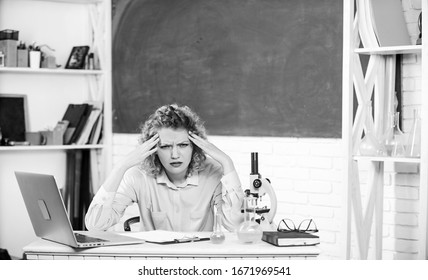 Pressure nervous tense. Teacher stressful occupation. Stressful scientist. Girl tired stressful expression with laptop and microscope working investigation biology and chemistry. Stressful educator.