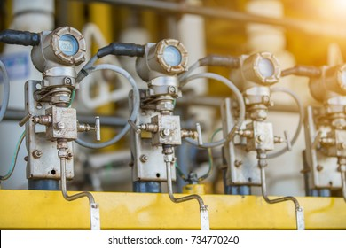 Pressure transmitter at offshore oil and gas central processing platform use for monitor pressure of gas and crude produced well and sending data to programmable logic controller for automatic control