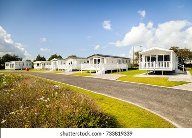 Prestatyn, Gorant, North Wales Great Britain, UK- Sep 08 2017 : A row of six berth luxury static caravans with verandas, private parking bays at Presthaven sands holiday park North Wales U.K.