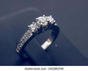 Prestigious and beautiful gold ring with three diamond stone. jewelry product catalogue.