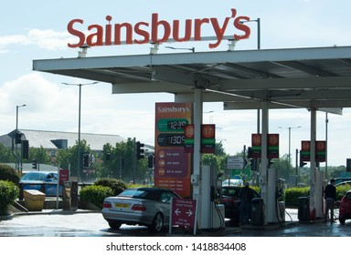 Preston, Lancashire/UK: June 6th 2019: Sainsbury's petrol station with cars and people