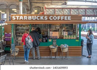 Preston,Lancashire/England - 13.05.2019 - Commuters queuing and enjoying Starbucks Coffee at Preston railway station