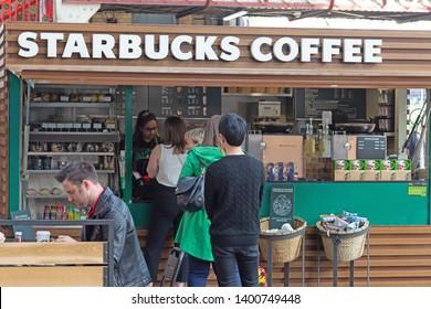 Preston,Lancashire/England - 13.05.2019 - Passengers queuing at Starbucks Coffee at Preston railway station