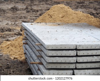 Prestressed Floor planks stacked for construction. It is a slab of reinforced concrete. Put together Structural Topping (concrete composite topping) will work in the same with the finished floor.