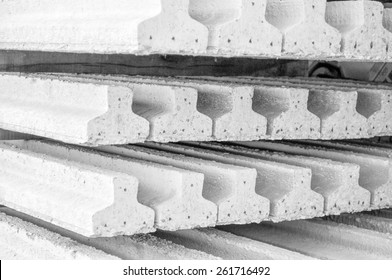 Prestressed precast pretensioned reinforced concrete beam in black and white