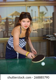 preteen beautiful girl play table tennis in the beach resort hotel recreation area