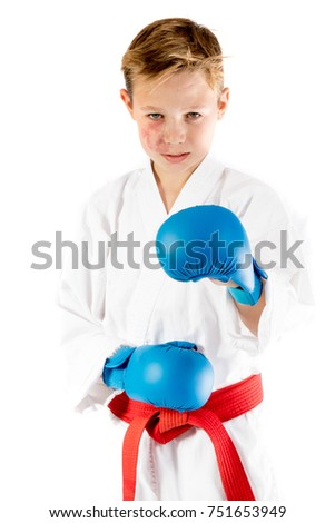 Pre-teen boy doing karate on a white background