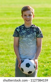 Pre-teen boy holding a football