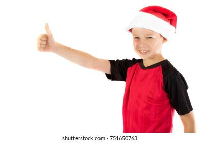 Pre-teen boy wearing a santa hat looiking happy isolated on white