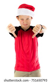 Pre-teen boy wearing a santa hat looking unhappy isolated on white