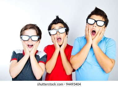 Preteen boys having fun, wearing 3D movie glasses and watching cinema, crazy facial expression, surprised kids, portrait of a screaming teens, children with open mouths