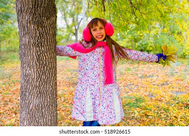 preteen girl in autumn park with leafs near the tree, smiling, vacation, autumn, outdoors