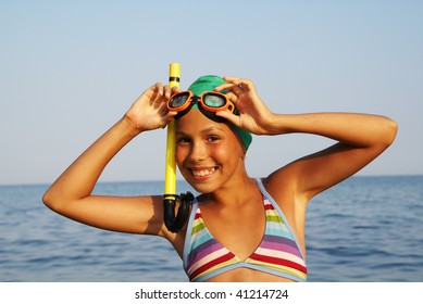 Preteen girl in diving outfit enjoying sun-bath on sea beach