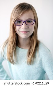 preteen girl with glasses