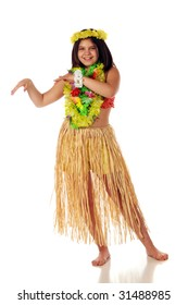 A preteen girl in Hawaiian leis and a grass skirt preparing to dance Hawaiian style.  Isolated on white.
