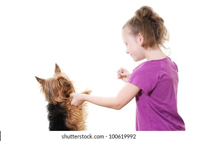 preteen girl playing with pet dog