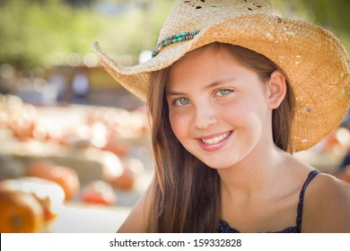 Preteen Girl Portrait Wearing Cowboy Hat at Pumpkin Patch in Rustic Setting. 018ad271b610