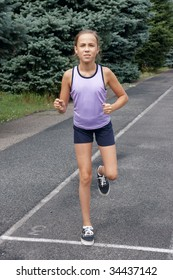 Preteen girl running on track