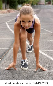 Preteen girl starting to run on track