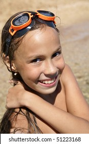 Preteen girl in swiming outfit enjoying sun-bath on sea beach