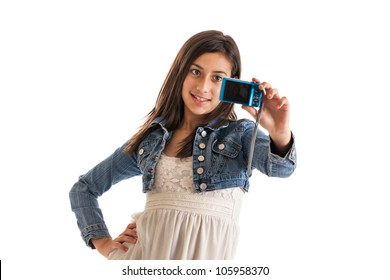 Preteen girl taking a picture of herself with digital camera isolated on white