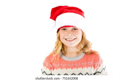Pre-teen girl wearing a santa hat on a white background
