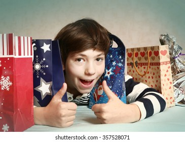 preteen handsome boy with christmas presents bag close up smiling cute portrait