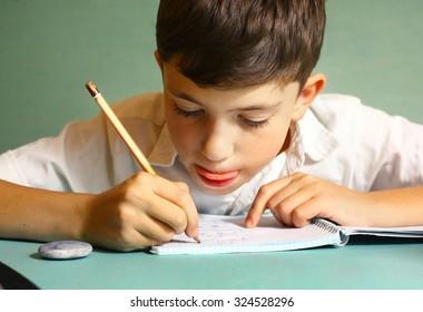 preteen handsome boy drawing portrait