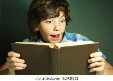 preteen hansome boy reading book have fun. Reading boy
