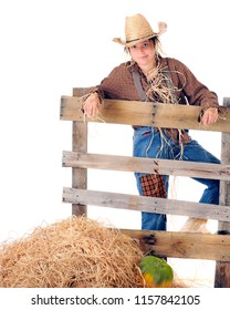 """A preteen """"scarecrow"""" leaning on a rustic rale fence.  On a white background with space on the left for your text."""