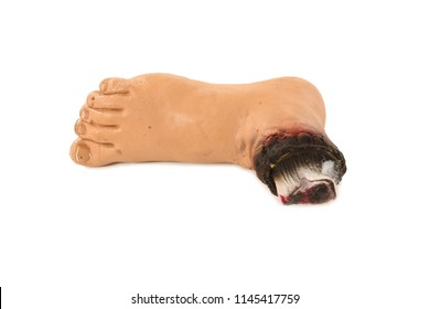 A pretend gory chopped off foot for Halloween. Studio photo taken on white background.