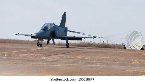 PRETORIA, SOUTH AFRICA -12 MAY 2012 - A Hawk Mk 120 in SAAF colors after landing with a drogue parachute during the Swartkop Warbird Centenary airshow on 12 May 2012 at Swartkop Airforce Base