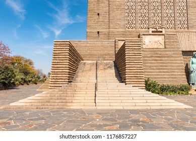 PRETORIA, SOUTH AFRICA, JULY 31, 2018: A staircase at the entrance to the Voortrekker Monument  in Pretoria. A relief panel of a black wildebeest is visible