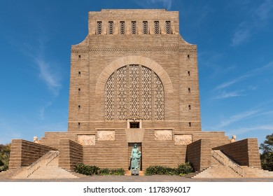 PRETORIA, SOUTH AFRICA, JULY 31, 2018: The Voortrekker Monument, on Monument Hill in Pretoria. It was built with granite. The bronze sculpture of a Voortrekker woman and two children is visible