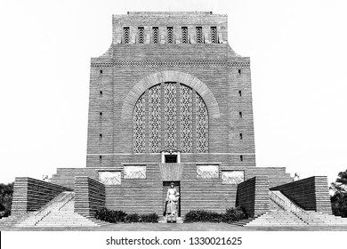 PRETORIA, SOUTH AFRICA, JULY 31, 2018: The Voortrekker Monument, on Monument Hill in Pretoria. Built with granite. The bronze sculpture of a Voortrekker woman and two children is visible. Monochrome