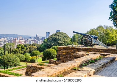 Pretoria, South Africa - May 23, 2019: View from the Union Buildings of its terraced gardens with the historic naval gun and the skyline in the background