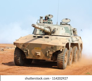 PRETORIA, SOUTH AFRICA -SEPT. 19: a Rooikat armored fighting vehicle from Denel Land Systems in action during the African Aerospace & Defence show on Sept. 19, 2012 at AFB Waterkloof in Pretoria.