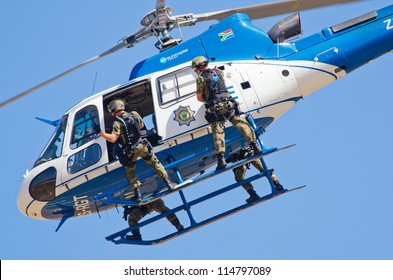 PRETORIA, SOUTH AFRICA -SEPT. 23:  A Police Force helicopter during a mock arrest at the African Aerospace & Defence show on Sept. 23, 2012 at AFB Waterkloof in Pretoria.