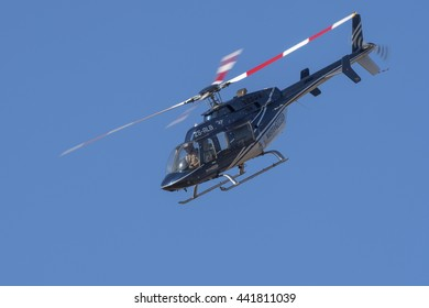 PRETORIA, SOUTH AFRICA-JUNE 11 2016: Menno Parsons puts his Bell 407  helicopter into a shallow dive at the Airlink Adrenaline Airshow at Wonderboom Airport.