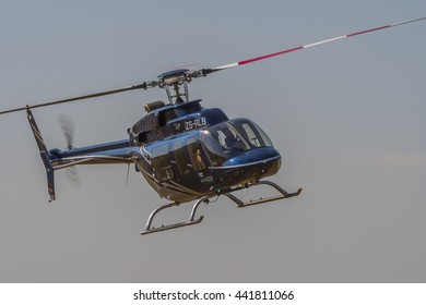PRETORIA, SOUTH AFRICA-JUNE 11 2016: Menno Parsons flys past in his Bell 407  helicopter at the Airlink Adrenaline Airshow at Wonderboom Airport.