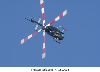 PRETORIA, SOUTH AFRICA-JUNE 11 2016: Menno Parsons performs a steep bank in his Bell 407  helicopter at the Airlink Adrenaline Airshow at Wonderboom Airport.