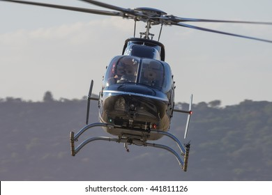 PRETORIA, SOUTH AFRICA-JUNE 11 2016: Close to Menno Parsens hovering his Bell 407  helicopter at the Airlink Adrenaline Airshow at Wonderboom Airport.