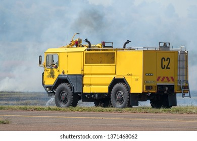 PRETORIA, SOUTH AFRICA-MAY 5 2018: SAAF Fire Service with bright yellow fire engine killing a veld fire at the Swartkops Museum Airshow