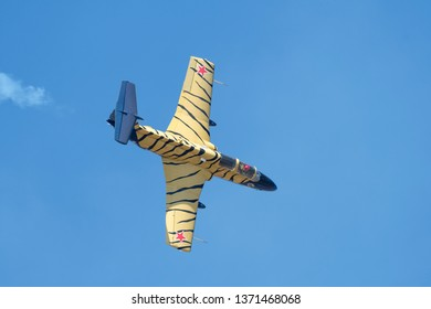 PRETORIA, SOUTH AFRICA-MAY 5 2018: L-29 Dolphin  with tiger stripes in a shallow dive at the Swartkops Museum Airshow