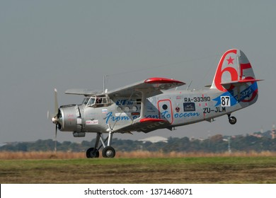 PRETORIA, SOUTH AFRICA-MAY 5 2018: Little Annie an Antonov AN-2  biplane with radial engine doing a rolling landing at the Swartkops Museum Airshow