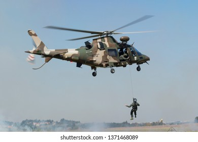 PRETORIA, SOUTH AFRICA-MAY 5 2018: SAAF Augusta  A109 helicopter hoisting a person with a wire rope during mini air war at the Swartkops Museum Airshow