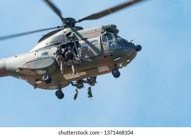 PRETORIA, SOUTH AFRICA-MAY 5 2018: SAAF museum Puma helicopter  deploying troops via ropes during mini air war at the Swartkops Museum Airshow