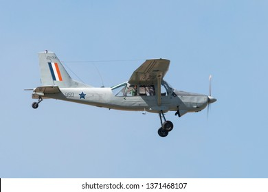 PRETORIA, SOUTH AFRICA-MAY 5 2018: Slow fly past with Bosbok in old SAAF colours at the Swartkops Museum Airshow