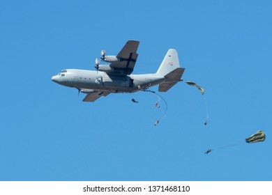PRETORIA, SOUTH AFRICA-MAY 5 2018: Lockheed Hercules C-130  deploying paratroopers at the Swartkops Museum Airshow